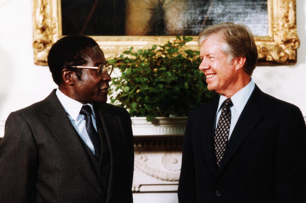Robert Mugabe naast Amerikaans president Jimmy Carter 27 augustus 1980., Getty Images