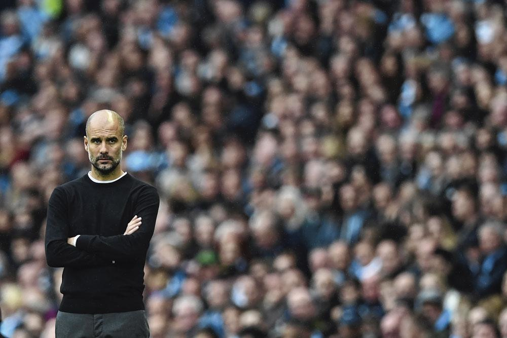 PEP GUARDIOLA, AFP