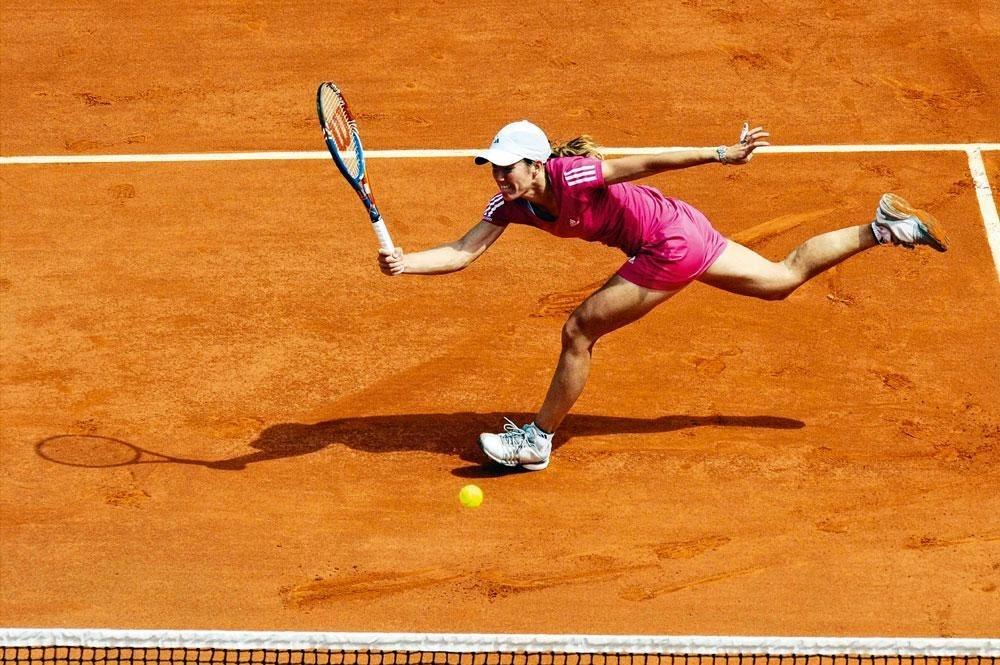 Justine Henin: 'In mijn tenniscarrière slaagde ik er zelfs buiten het seizoen niet in om eens even te genieten met vrienden.', belgaimage