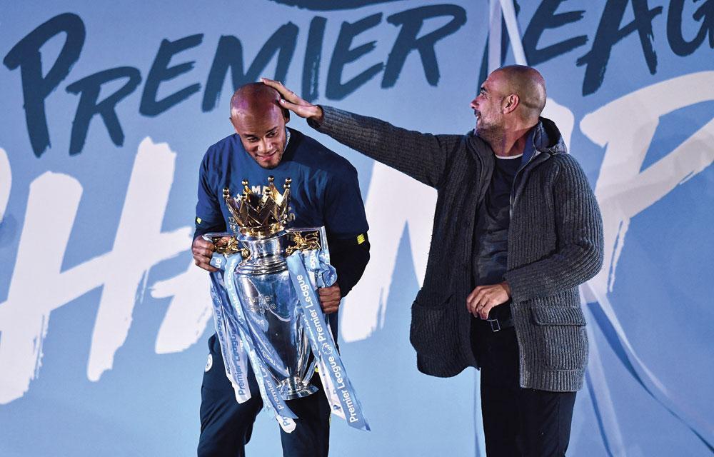 Kompany et Guardiola ont de nombreux points communs, à commencer par leur coiffure., BELGAIMAGE