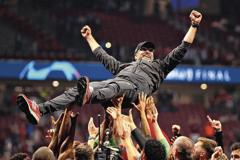 Jürgen Klopp: 'Voetbalclubs spreken vaak over het team achter het team, maar hier zijn dat geen loze woorden. Iedereen die voor deze club werkt weet dat hij of zij belangrijk is.', GETTY